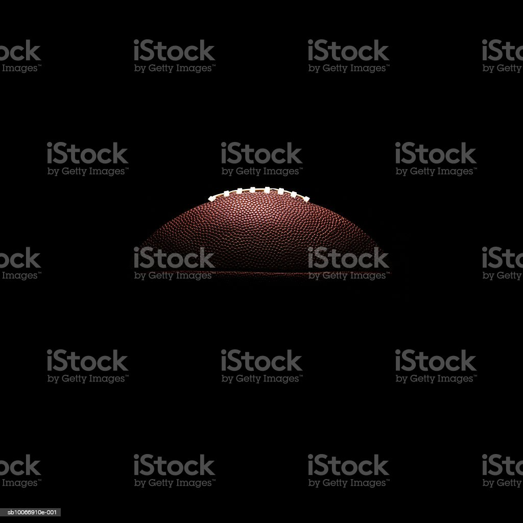 American football ball on black background royalty-free stock photo