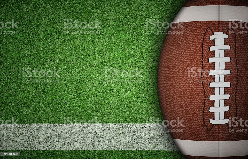 American Football Ball on Grass stock photo