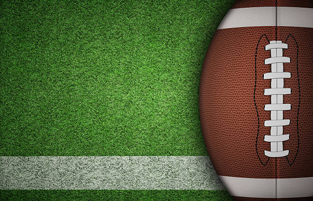 American Football Ball on Grass American football ball on green grass and white line. with lots of copy space. american football field stock pictures, royalty-free photos & images