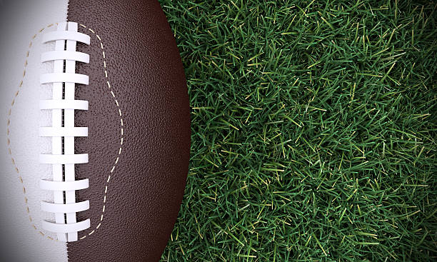 American Football Ball On Realistic Grass American football ball concept with realistic grass. Copyspace included. ncaa college football stock pictures, royalty-free photos & images