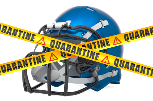american football ball with caution barrier tape. cancellation of football match, quarantine concept. 3d rendering isolated on white background - covid testing zdjęcia i obrazy z banku zdjęć