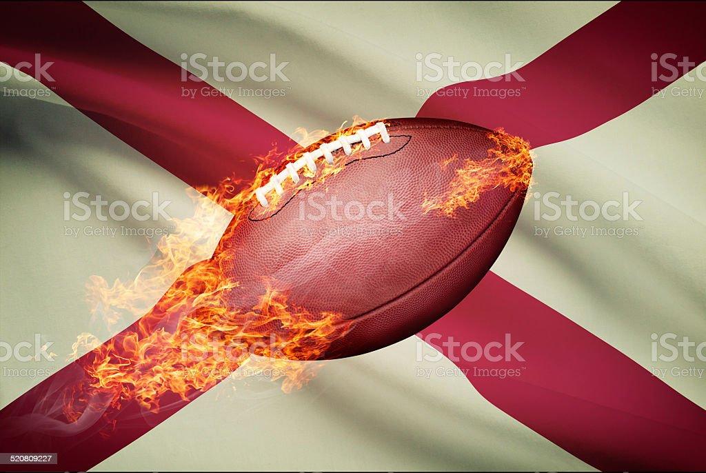 American football ball with flag on backround series - Alabama stock photo