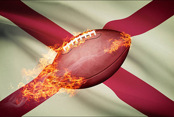 American football ball with flag on backround series - Alabama stock photo