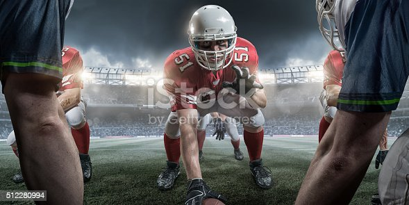 istock American Football Center in Offensive Line About to Snap Ball 512280994
