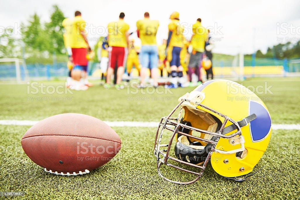 American football eqipment on grass stock photo
