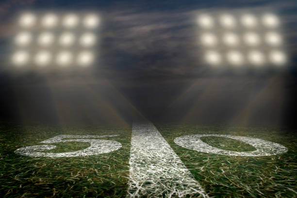 american football field 50 yard line friday night lights - high school sports stock pictures, royalty-free photos & images
