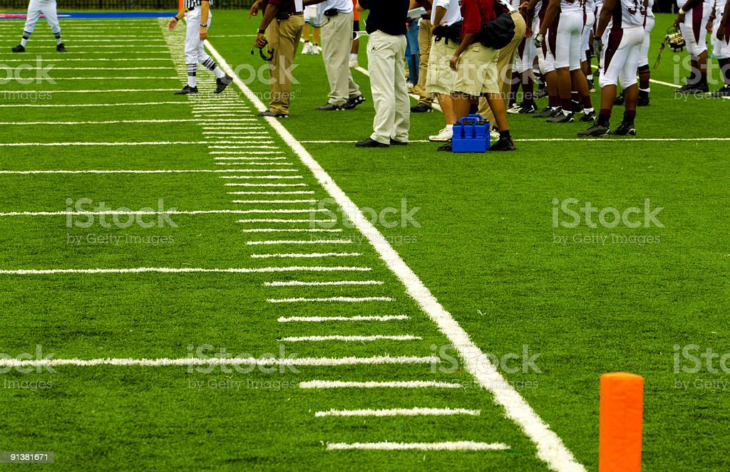 American Football Field and Football Players during a Football Game stock photo