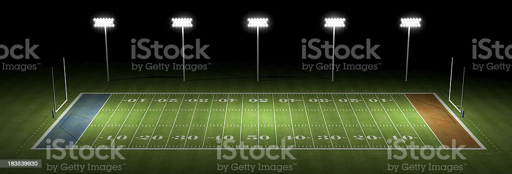 American football field at night stock photo