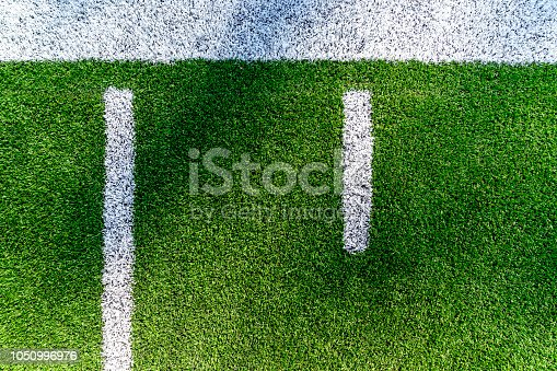An American football field yard line background aerial view with copy space.