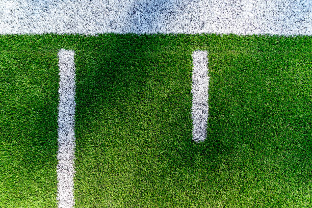 American Football Field Background Yard Line Aerial An American football field yard line background aerial view with copy space. american football field stock pictures, royalty-free photos & images
