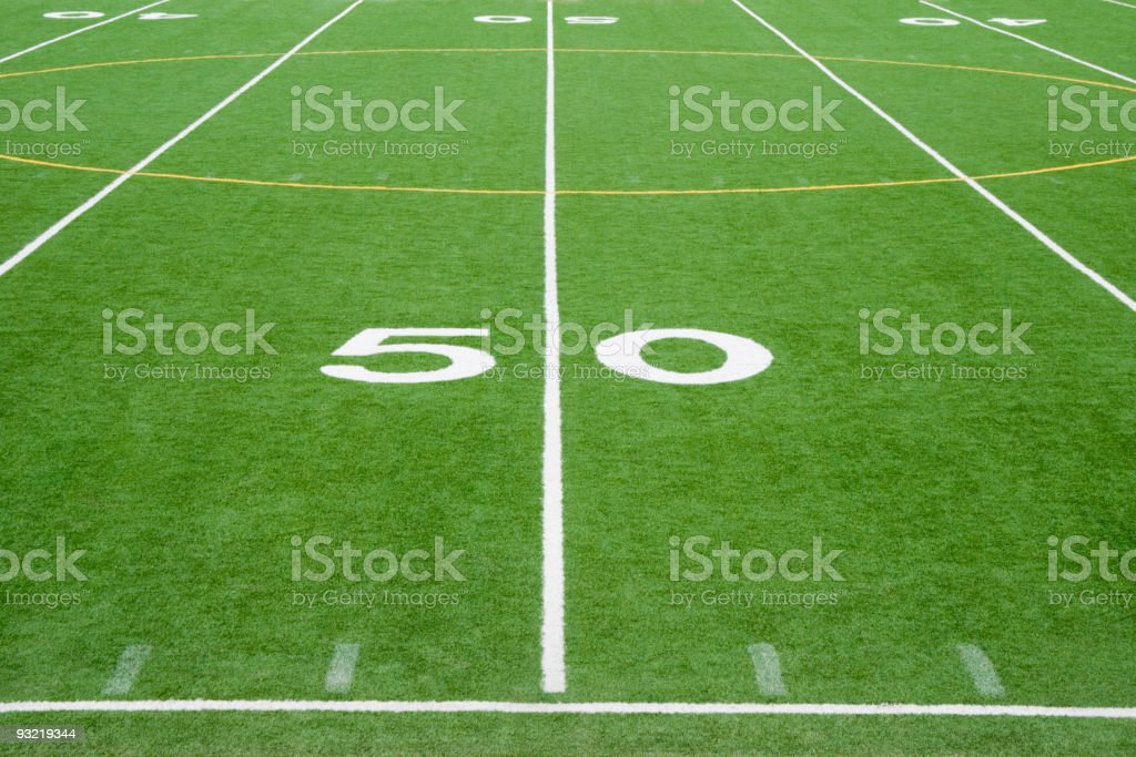American Football Field Fifty Yard Line in Grass stock photo