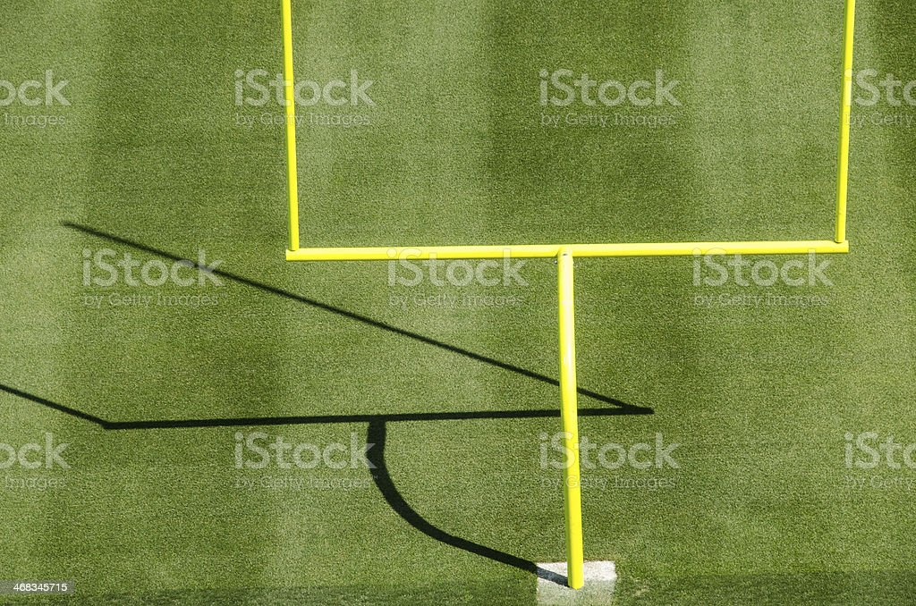 American Football Goalposts with Shadow on Field royalty-free stock photo