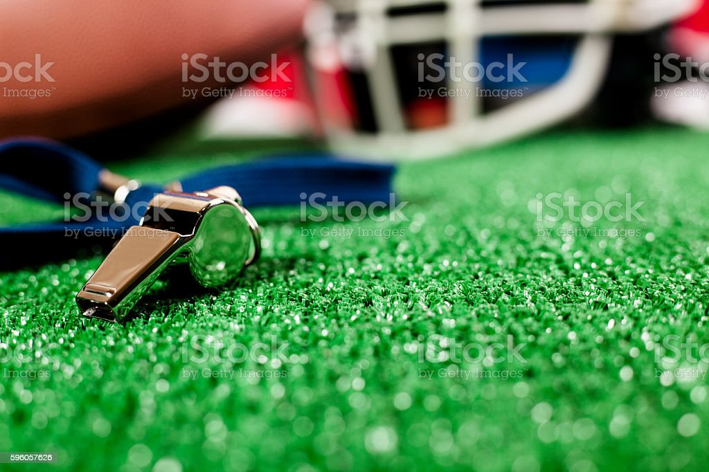 American football, helmet, green playing field turf with USA flag. royalty-free stock photo