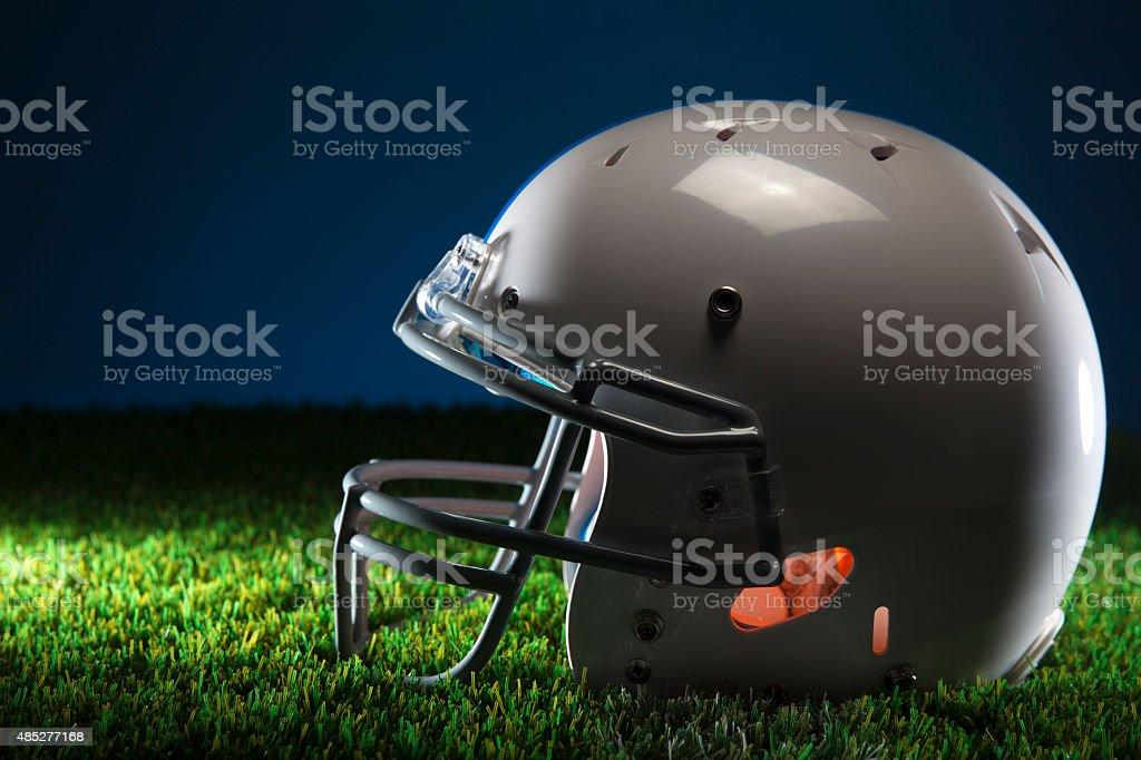 American Football Helmet on Green Grass stock photo