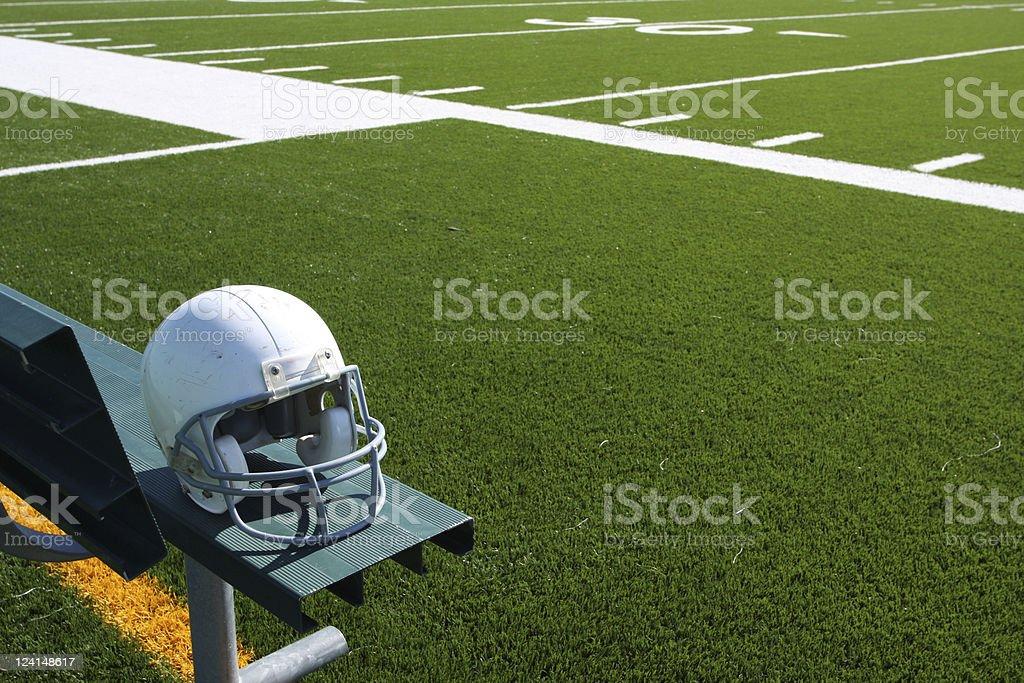 American Football helmet resting on a spectator bench stock photo