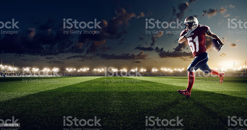 American football in action stock photo