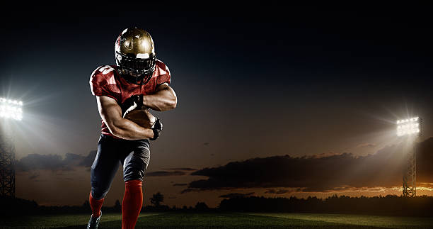american football in action - american football player stock photos and pictures