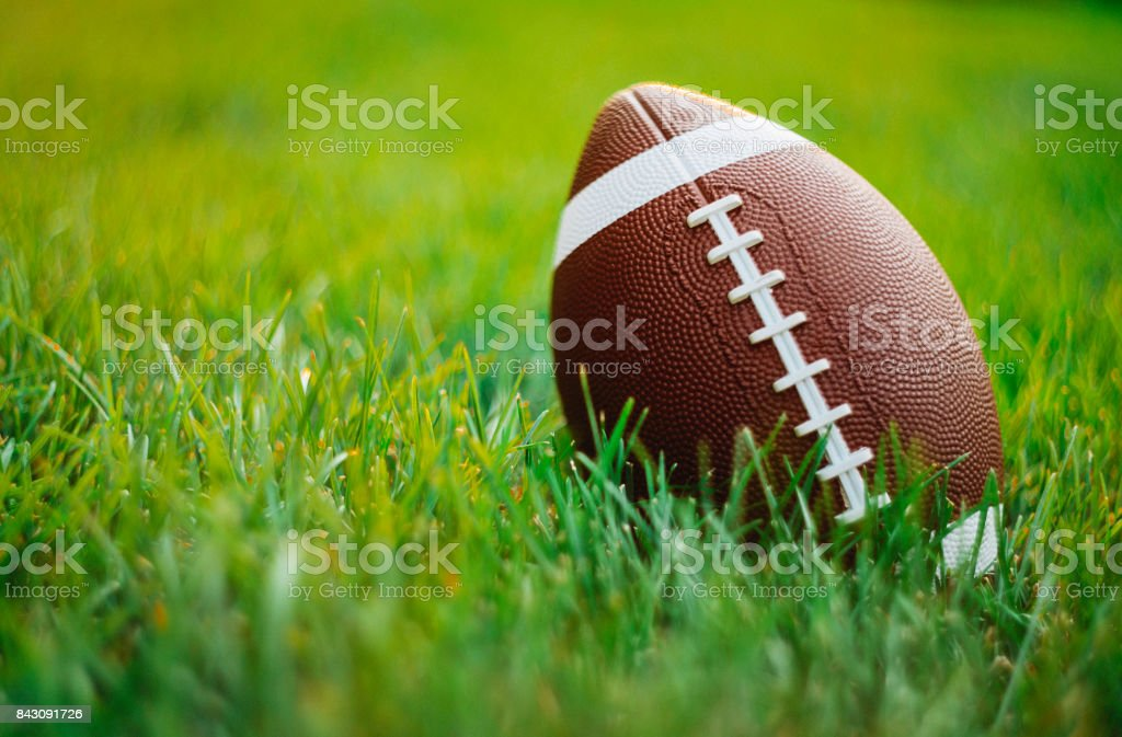 American Football in grass stock photo