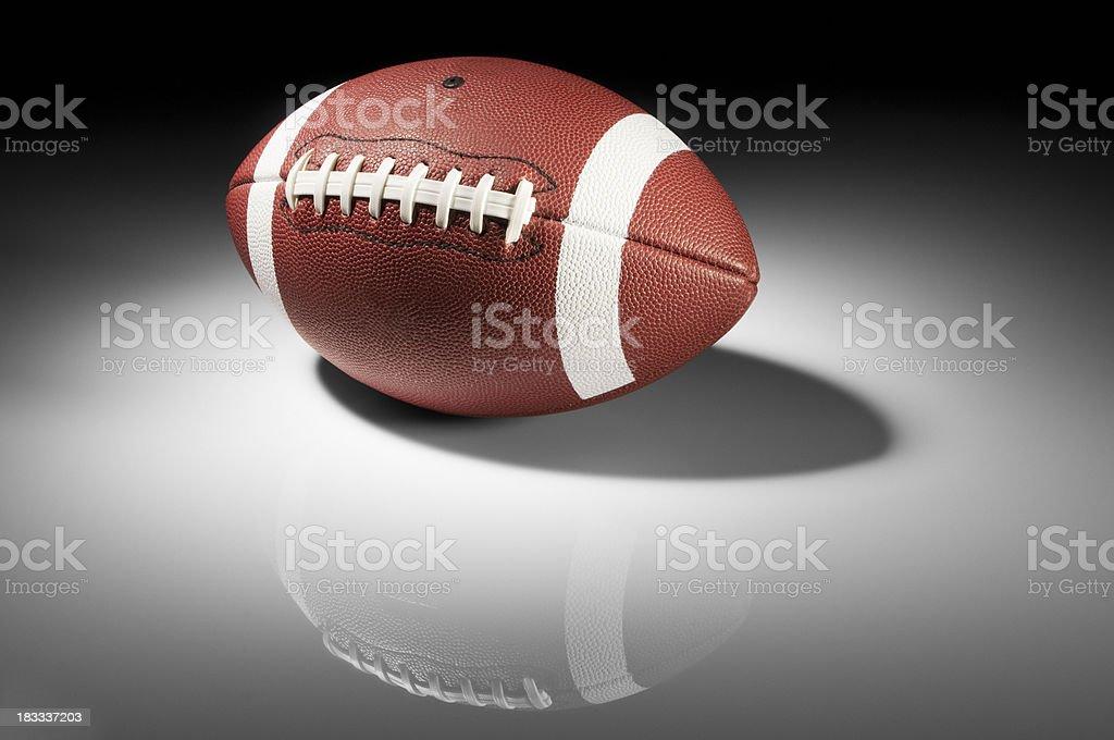 American football in spotlight on white background stock photo
