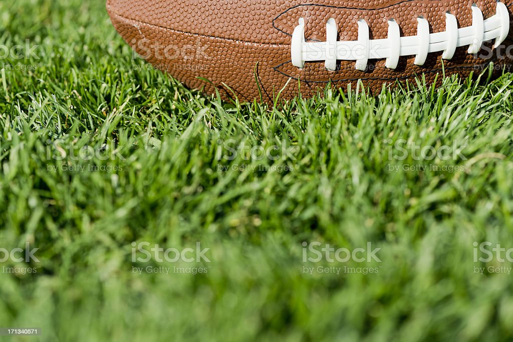 American Football in the field royalty-free stock photo