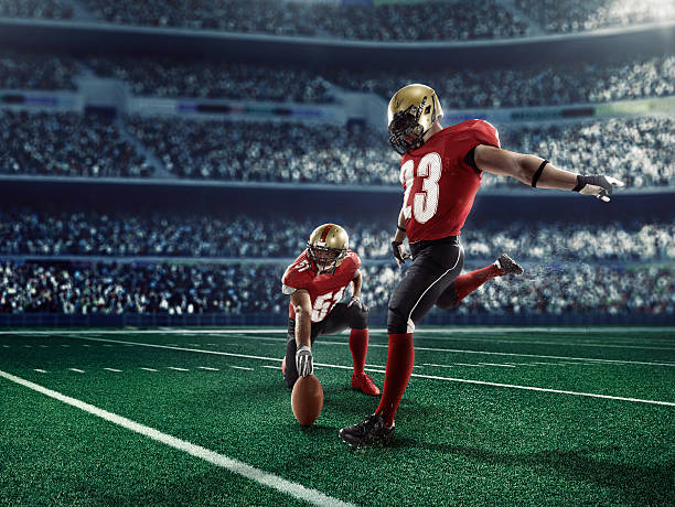 American football kick off stock photo