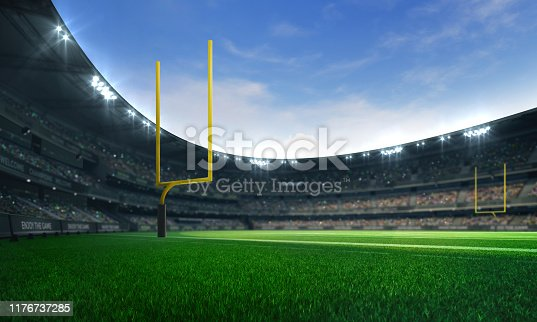 istock American football league stadium with yellow goalposts and fans, daytime field view 1176737285