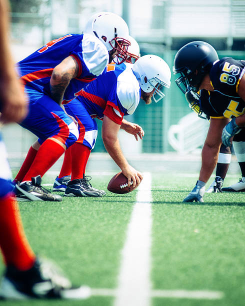 American Football Line of Scrimmage American Football Line of Scrimmage line of scrimmage stock pictures, royalty-free photos & images
