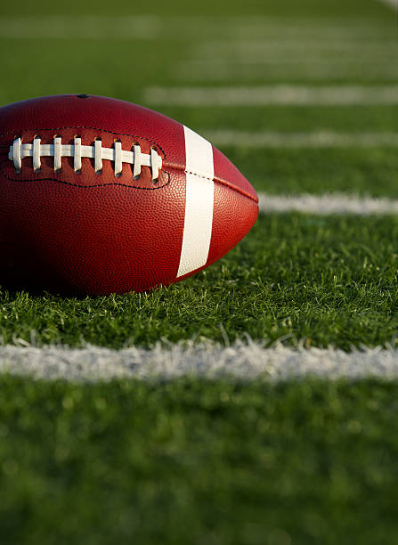 American Football near Yard Lines American Football on the Field near yard lines with room for copy ncaa college football stock pictures, royalty-free photos & images