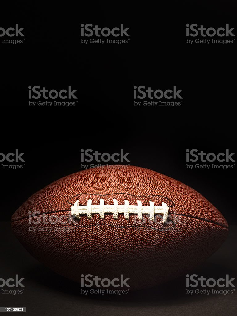 American football on black royalty-free stock photo