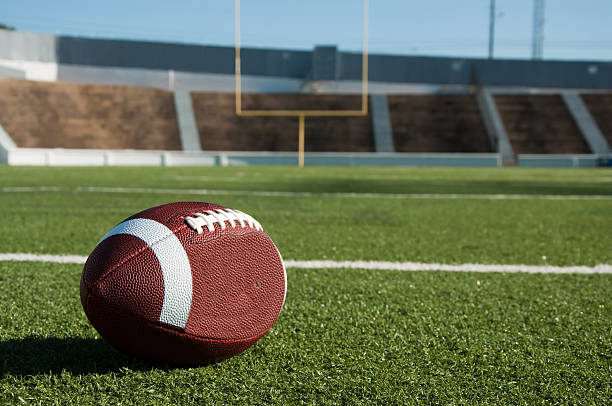 American Football on Field American football on field with goal post in background. american football field stock pictures, royalty-free photos & images