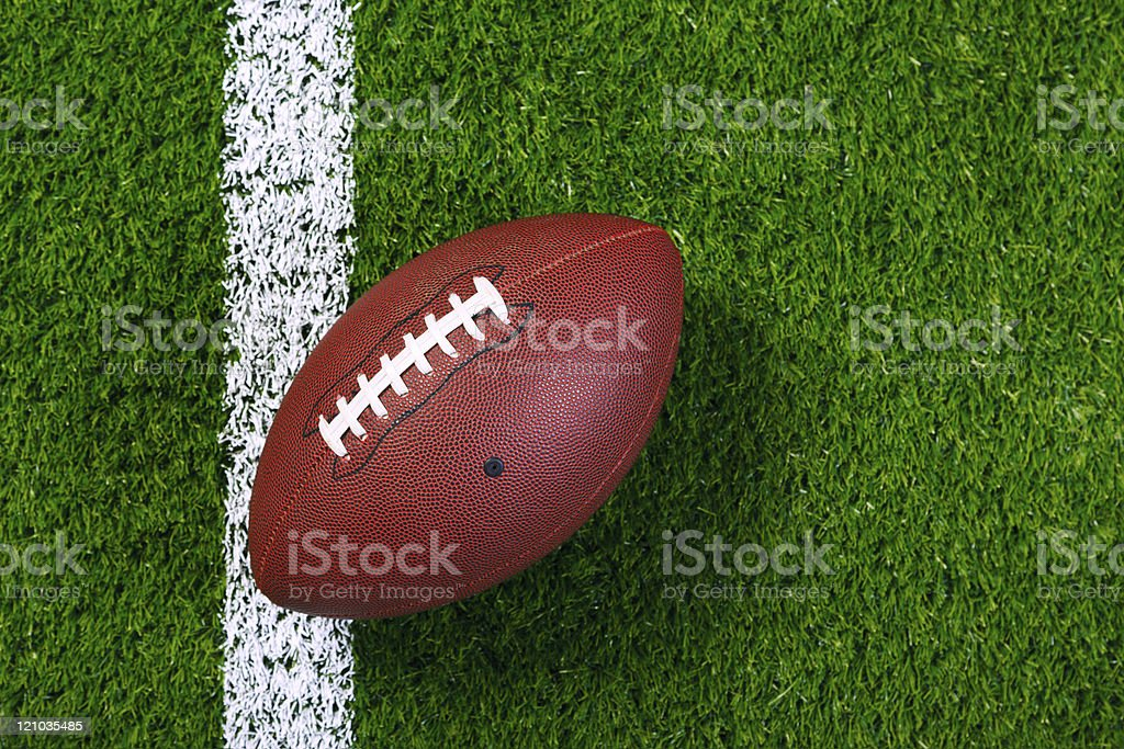 American football on grass from above. stock photo