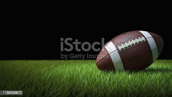 American football on green grass, on black background - 3D illustration