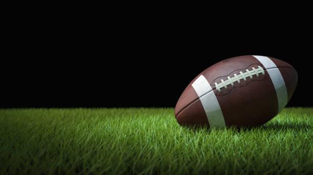 fútbol americano sobre hierba verde, sobre fondo negro - football fotografías e imágenes de stock