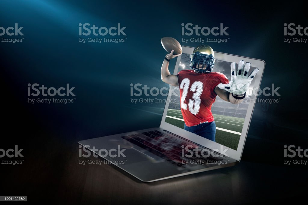 American football on laptop. Live broadcast stock photo