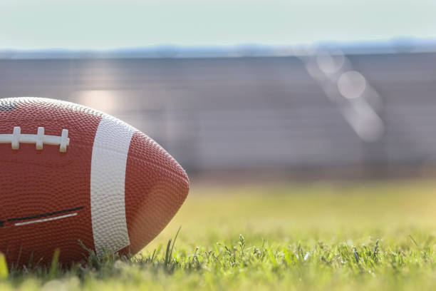 American football on stadium field at school campus. stock photo