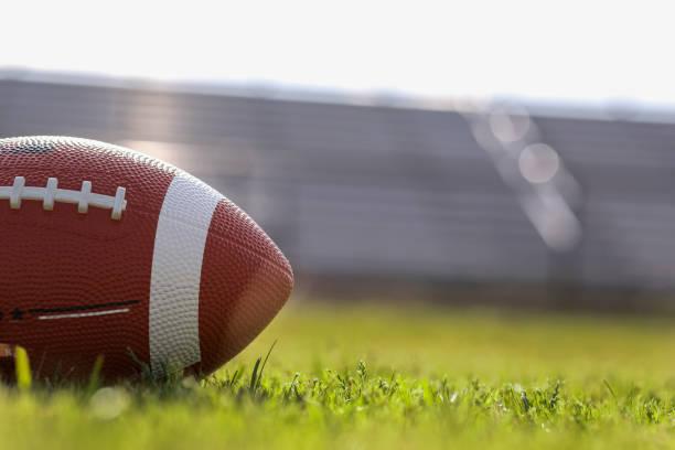 American football on stadium field at school campus. stock photo
