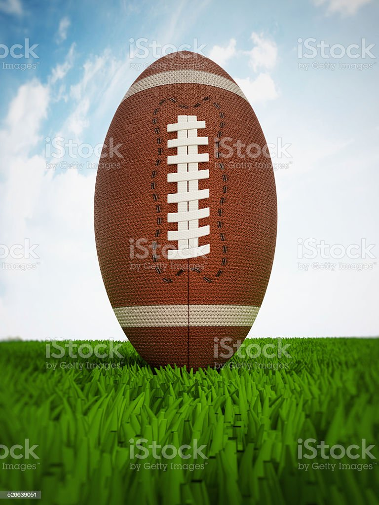 American football on the grass stock photo