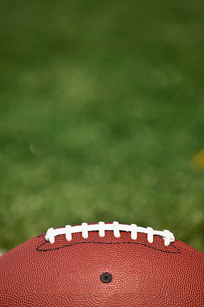 American football on the turf Pigskin ball ready for Monday Night on the field image stock pictures, royalty-free photos & images