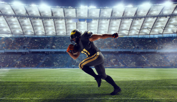 American football American football player in professional sport arena. american football uniform stock pictures, royalty-free photos & images