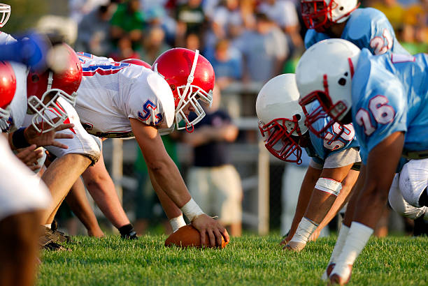 American football American high school football, line of scrimmage. line of scrimmage stock pictures, royalty-free photos & images
