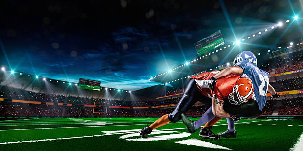 American football American football player in action american football player stock pictures, royalty-free photos & images