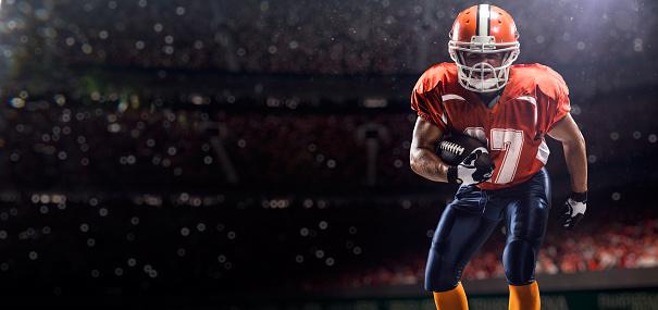 istock American football plaer on arena 520072237