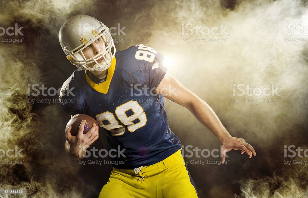 American Football play in smoke royalty-free stock photo