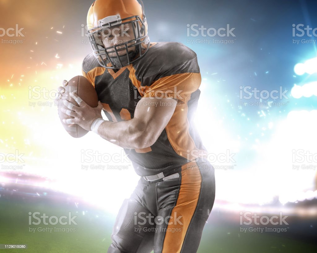 American Football Player At The Stadium In Black And Orange