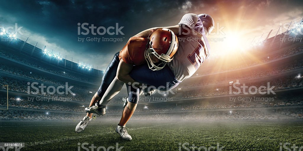 American football player being tackled royalty-free stock photo