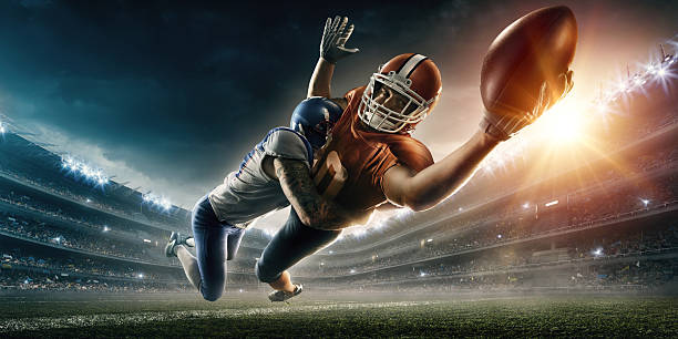 American football player being tackled Image of an american football player being tackled by the opposite team player during the flight to touchdown. All players wear unbranded professional clothes. Action takes place in a generic outdoor football stadium under a cloudy dark sky with bright sun. quarterback stock pictures, royalty-free photos & images