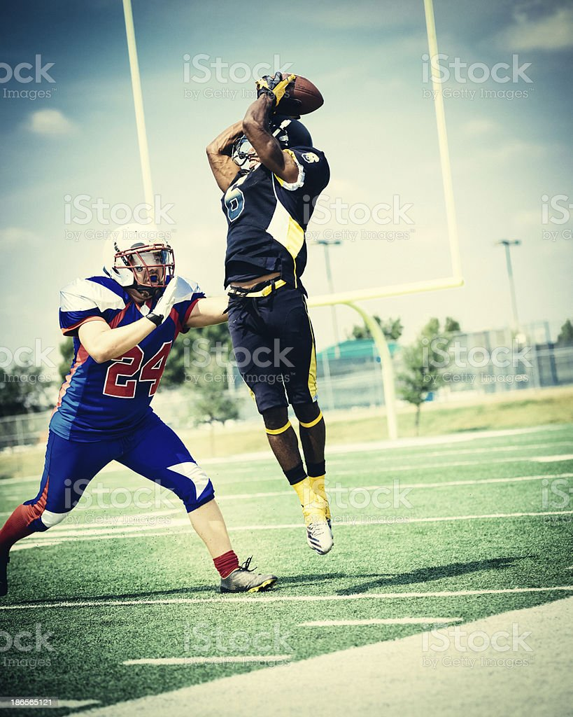 American Football Player Catching the ball stock photo