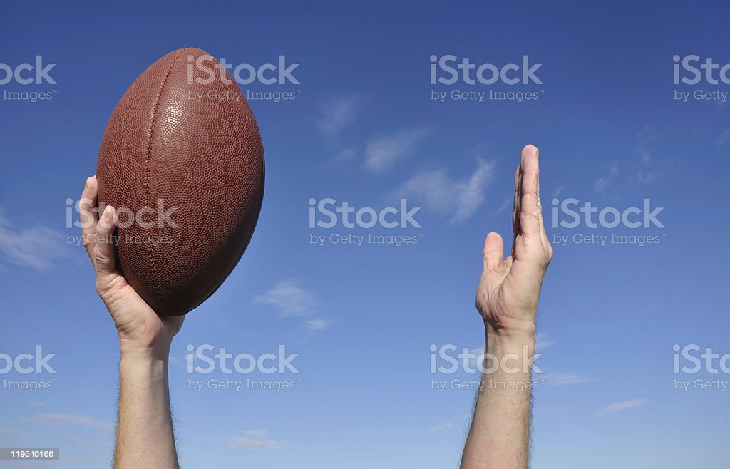 American Football Player Celebrates a Touchdown stock photo