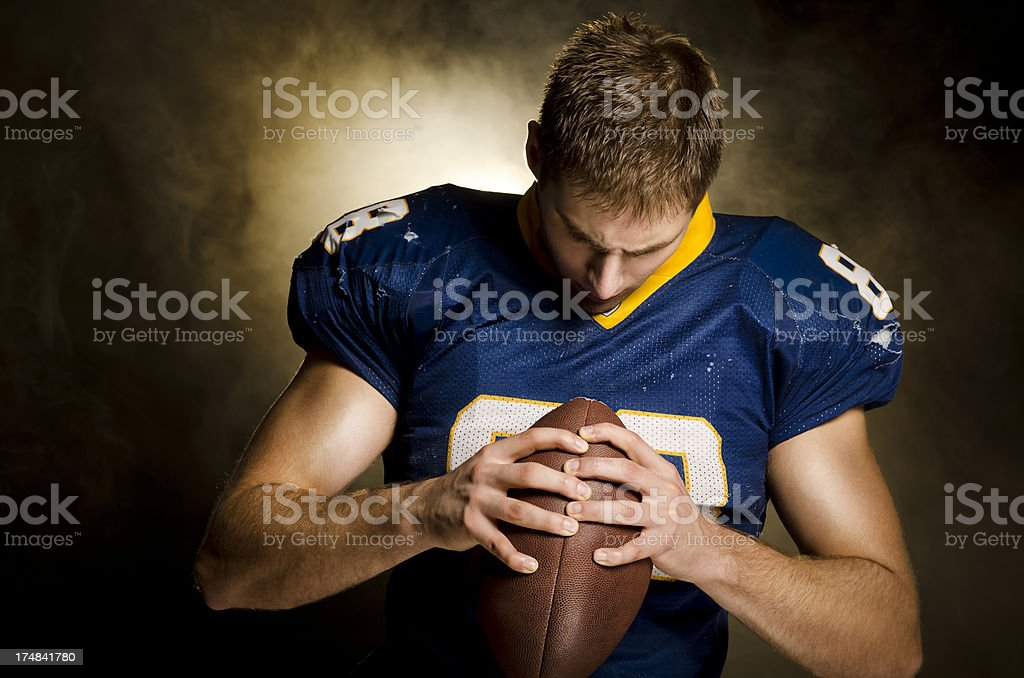 American Football Player contemplates royalty-free stock photo