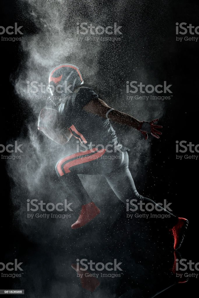 American football player in a haze on black background stock photo